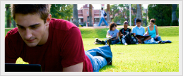 Photo of students sitting in the grass