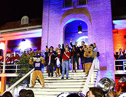 Photo from homecoming with Wilbur and Wilma Wildcat. Link to Gifts of Real Estate.